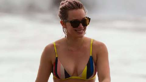 Newly divorced Hilary Duff flaunts her fabulous figure in beach bikini