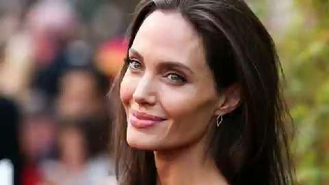 Angelina Jolie shows off three new giant tattoos